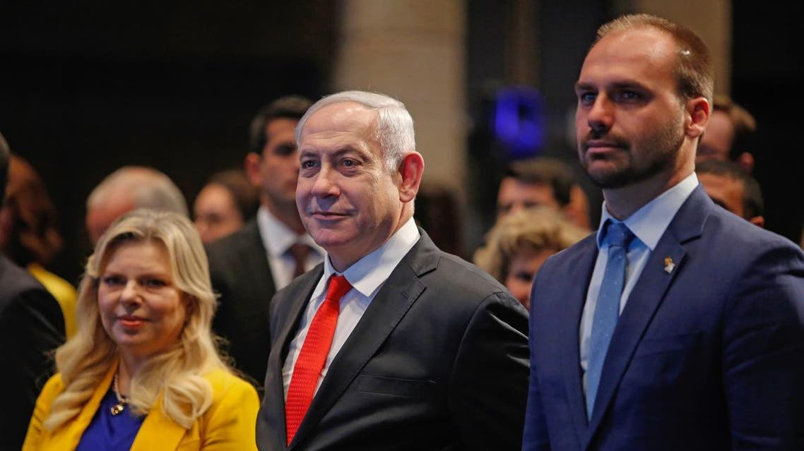 Israeli PM Netanyahu (L) and Brazilian Federal Deputy Eduardo Bolsonaro (R) attend the opening ceremony of the Brazilian Ministry trade office in Jerusalem on December 15, 2019. (AFP)