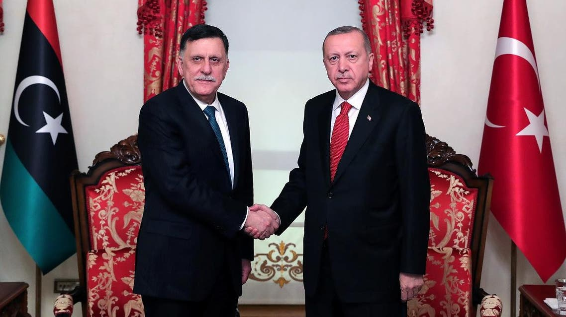 Turkish President Tayyip Erdogan meets with Libya's internationally recognised Prime Minister Fayez al-Sarraj in Istanbul, Turkey, on November 27, 2019. (Reuters)