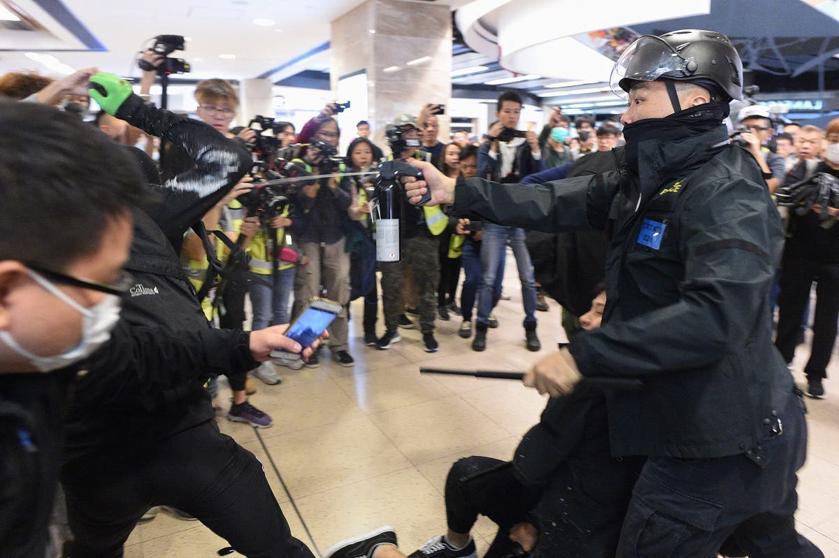 Police deploy pepper spray during a protest at the New Town Plaza shopping mall in Shatin in Hong Kong on December 15, 2019. (File photo: AFP)