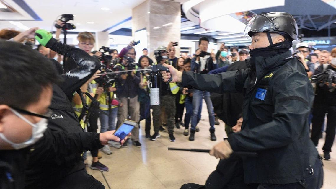 Police deploy pepper spray during a protest at the New Town Plaza shopping mall in Shatin in Hong Kong on December 15, 2019. (AFP)