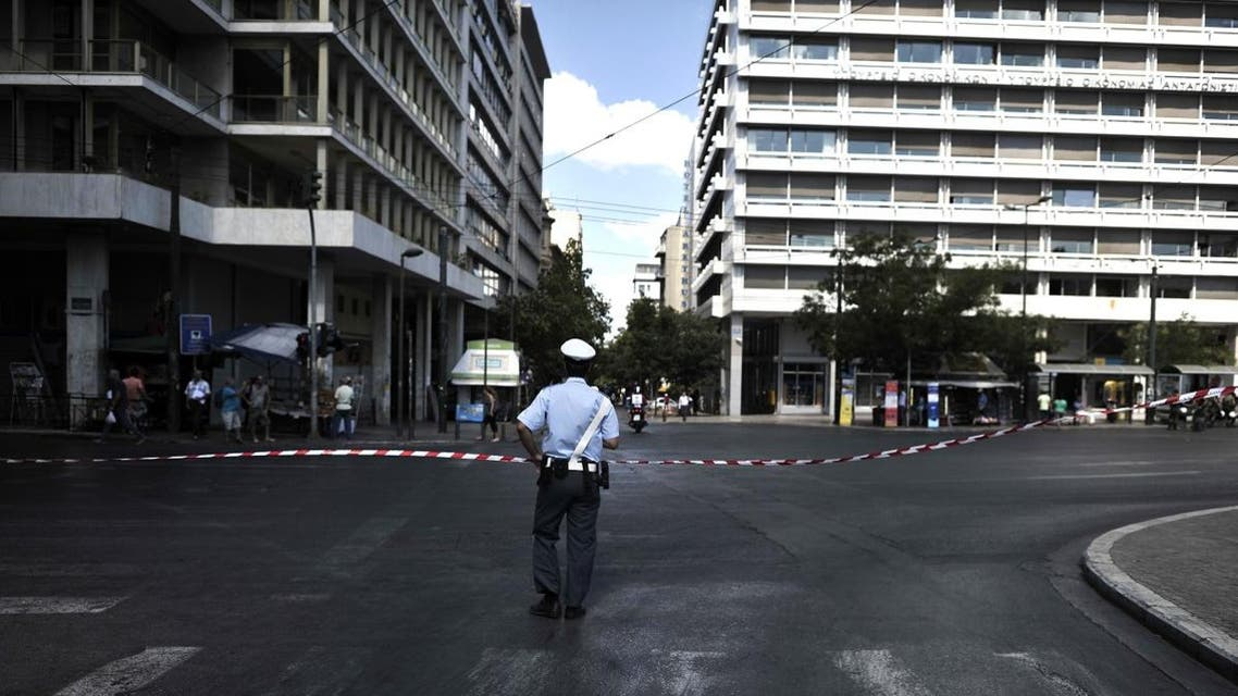 A traffic policeman stands at a blocked main avenue in Athens. (File photo: AFP)s stepped up security in the capital