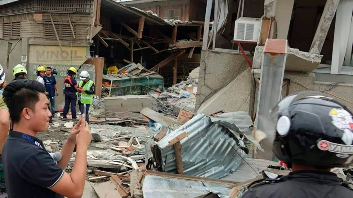 Residents and rescuers check damaged structures following an earthquake that struck Padada, southern Philippines on Sunday Dec. 15, 2019. (Photo: AP)