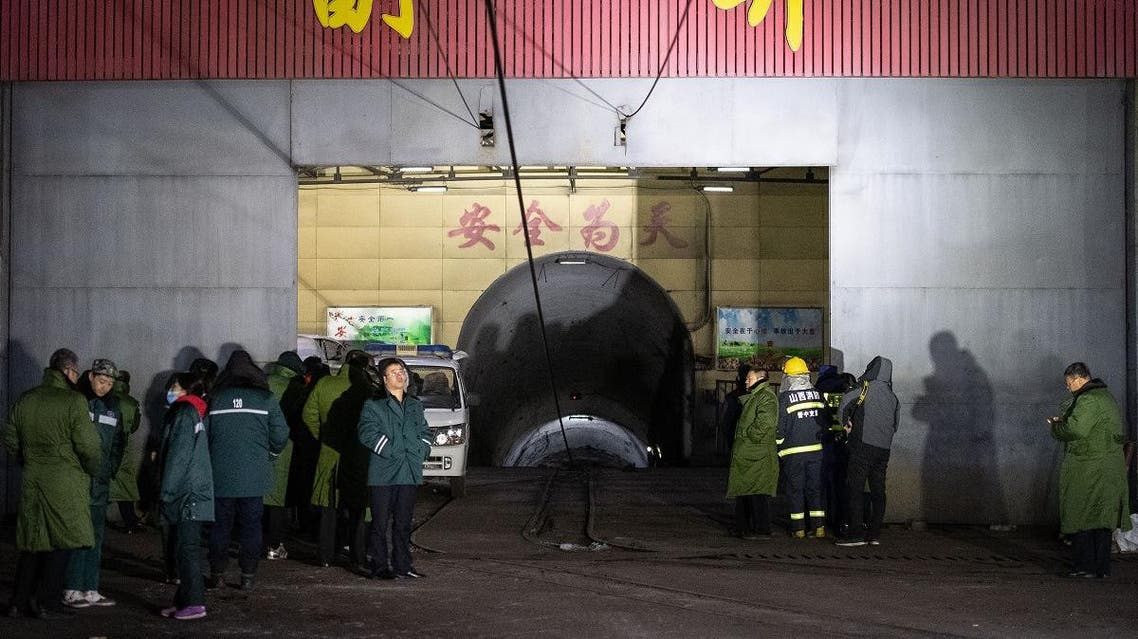 Rescuers and staff members wait outside the site of a coal mine explosion in Pingyao, in China's northern Shanxi province early on November 19, 2019. (AFP)