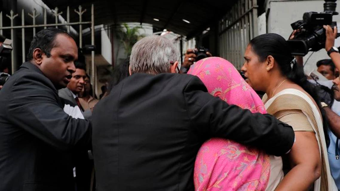 Sri Lankan Swiss embassy worker Gania Banister Francis, covered in pink shawl, is escorted by police to her a magistrate court after her arrest in Colombo, Sri Lanka. (Photo: AP)