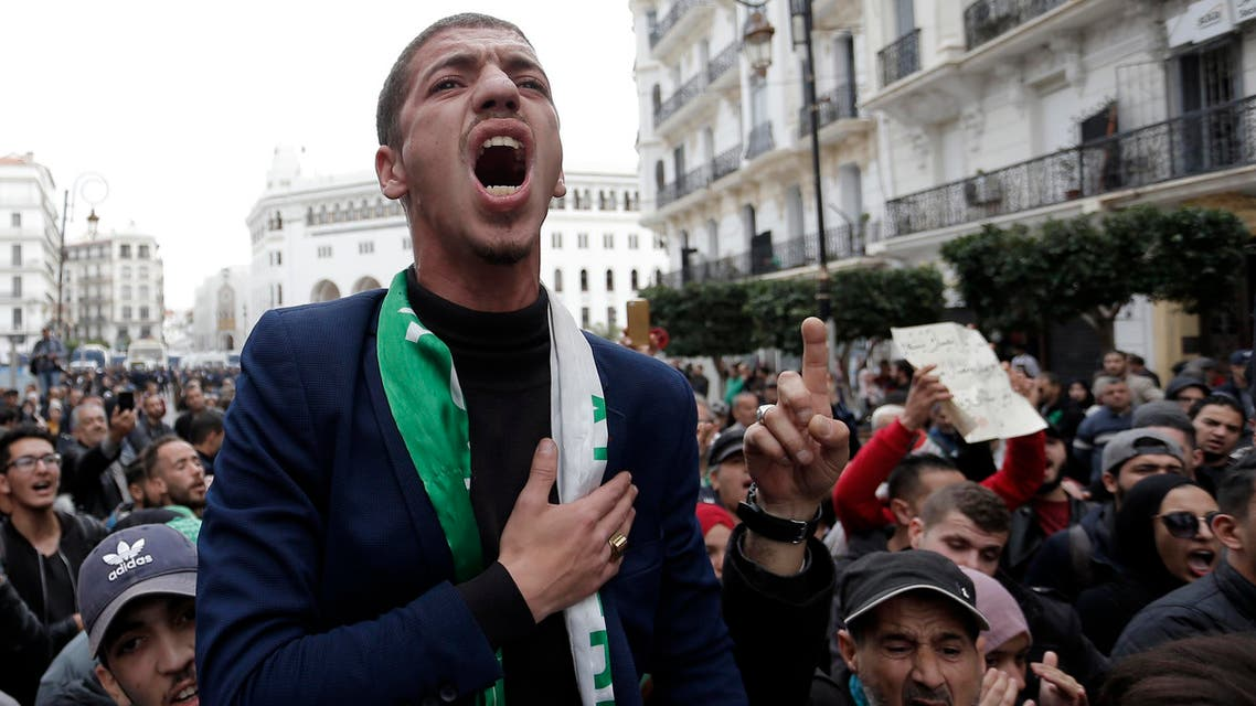 Algerian people take to the streets in the capital Algiers to reject the presidential elections and protest against the government, in Algiers, Algeria, Tuesday, Dec. 17, 2019. (AP)
