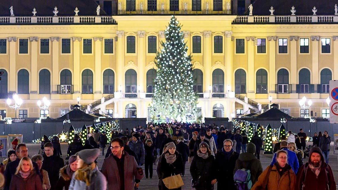 Visitors explore a Christmas market in front at Schoenbrunn palace in Vienna, Austria. (File photo: AFP)