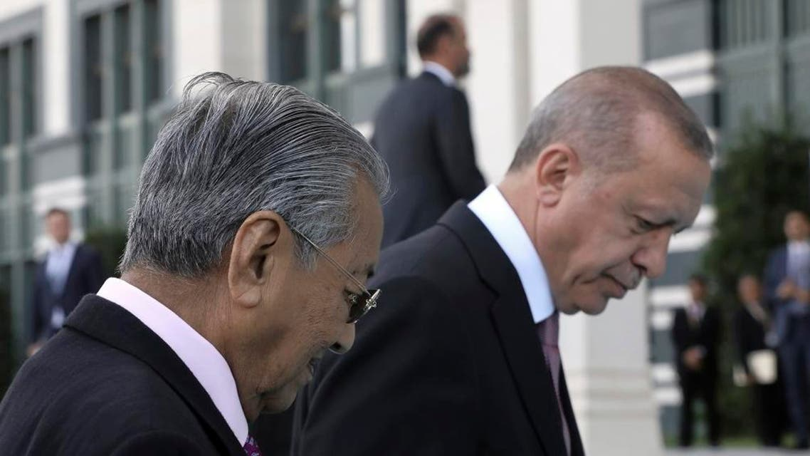 Turkey's President Recep Tayyip Erdogan, right, and Malaysia Prime Minister Mahathir Mohamad walk during a welcome ceremony, in Ankara, Turkey, Thursday, July 25, 2019. (Photo: AP)