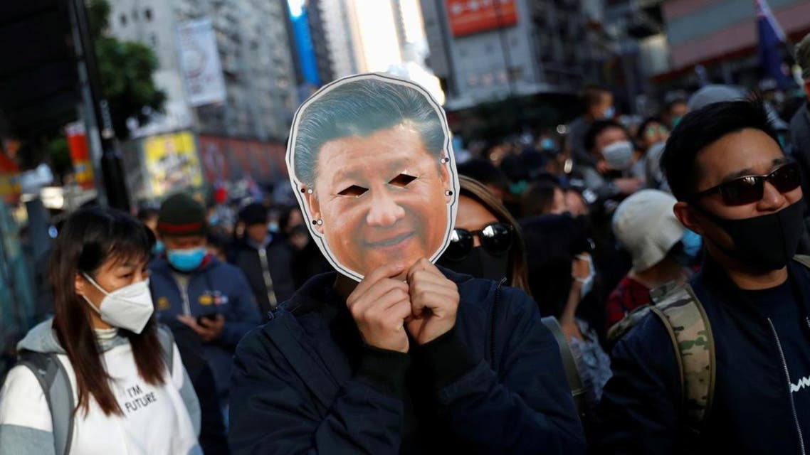 A protester holds a mask depicting China's President Xi Jinping at a Human Rights Day march in Hong Kong, China December 8, 2019. (File photo: Reuters)