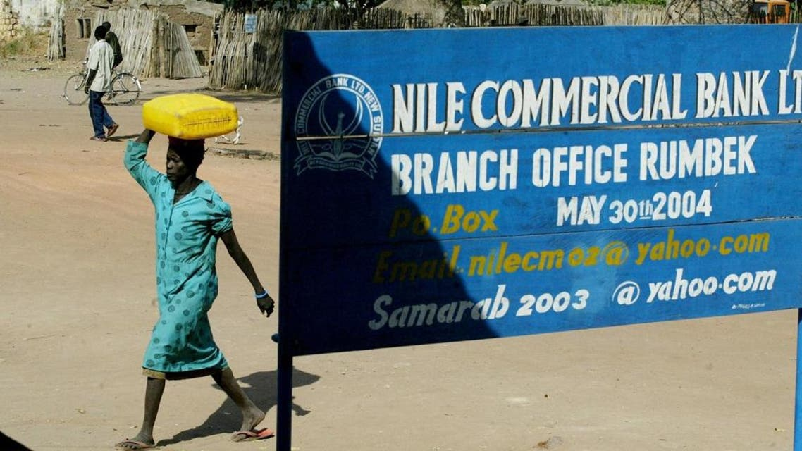 A Sudanese woman walks into a branch of the Nile Commerial Bank 20 January 2005. (AFP)