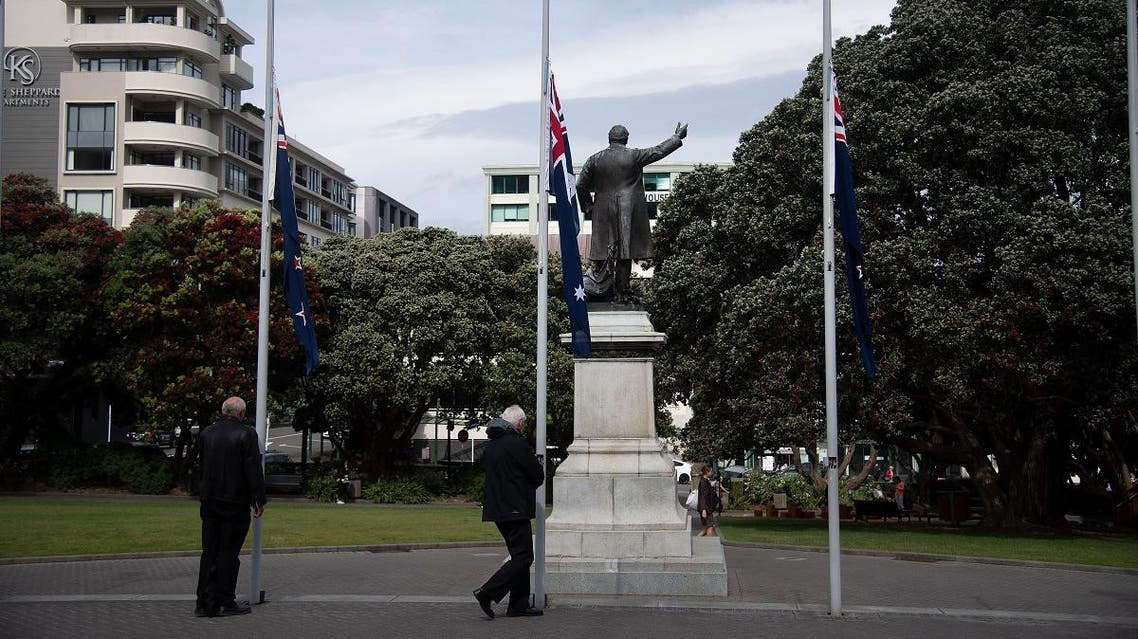 New Zealand flag (L and R) fly at half mast alongside an Australian flag (C) in respect for victims of the December 9 White Island volcanic eruption, at Parliament in Wellington on December 16, 2019. (AFP)