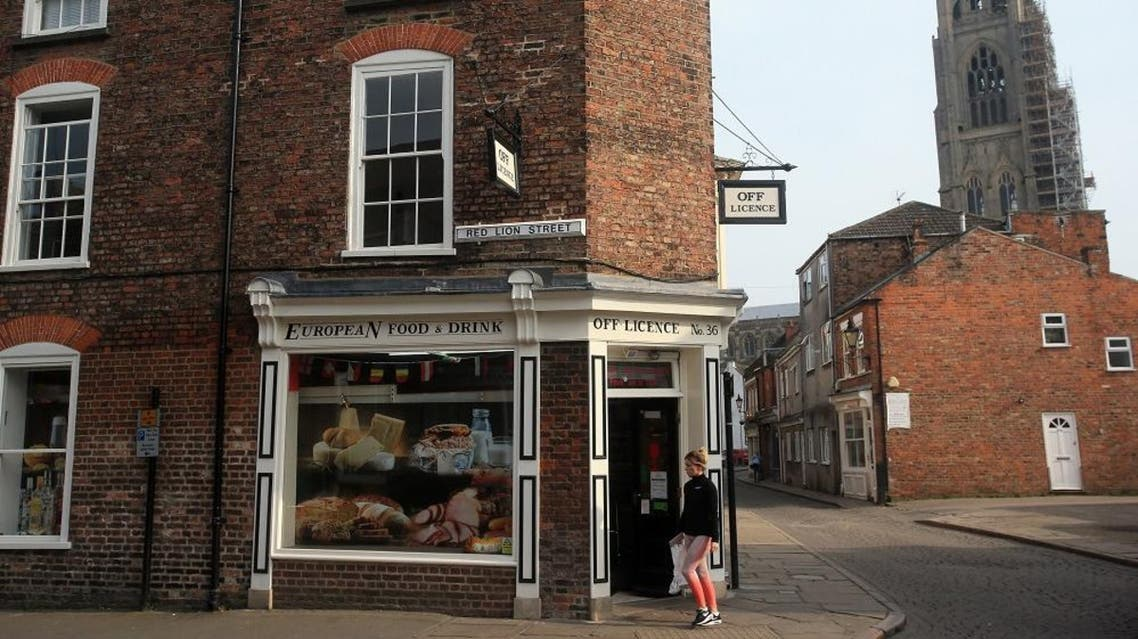 A pedestrian passes a European food store in the town of Boston in Lincolnshire. (File photo: AFP)