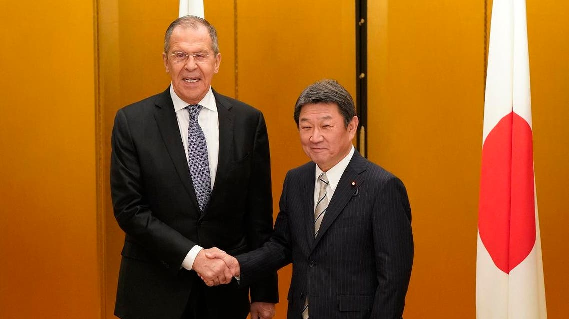 Japanese Foreign Minister Toshimitsu Motegi (R) shakes hands with Russian Foreign Minister Sergey Lavrov at the start of a bilateral meeting ahead the G20 Foreign Ministers' meeting in Nagoya on November 22, 2019. (AFP)