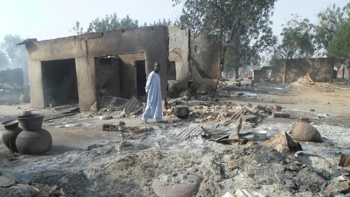 Jan. 31, 2016 file photo, a man walks past burnt out houses following an attacked by Boko Haram in Dalori village near Maiduguri (AP)