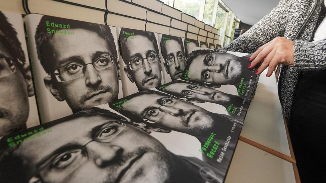 """Copies of the book titled """"Permanent Record"""" by US former CIA employee and whistleblower Edward Snowden are for sale on the sidelines of a video conference in that he spoke about the book on September 17, 2019 in Berlin. (AFP)"""