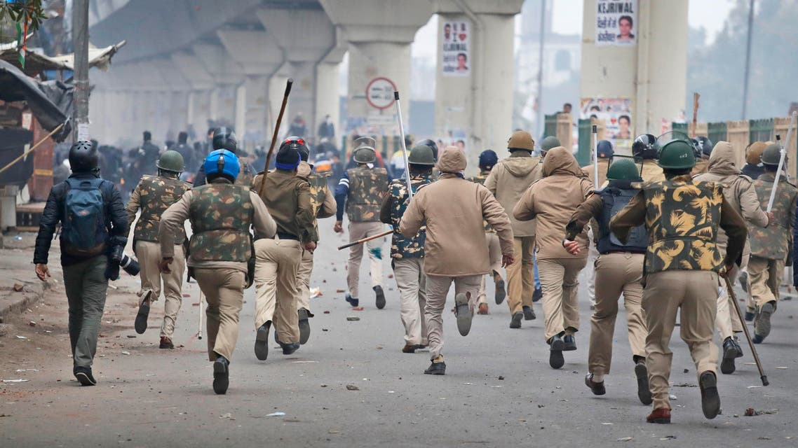 Policemen chase protesters during a protest against a new citizenship law at the Seelampur area of New Delhi, India, Tuesday, Dec. 17, 2019. (AP)