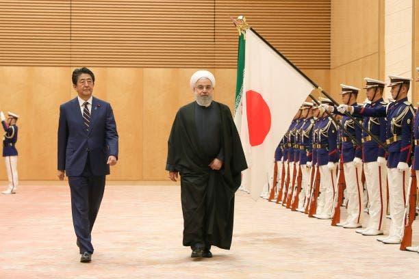 الرئيس روحاني ورئيس الوزراء الياباني خلال زيارته طوكيو