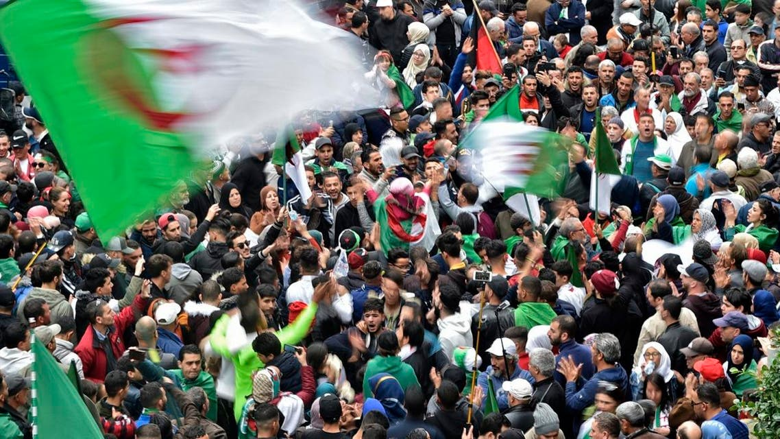 Algerian protesters wave national flags during an anti-government demonstration in the capital Algiers, on December 20, 2019. (AFP)