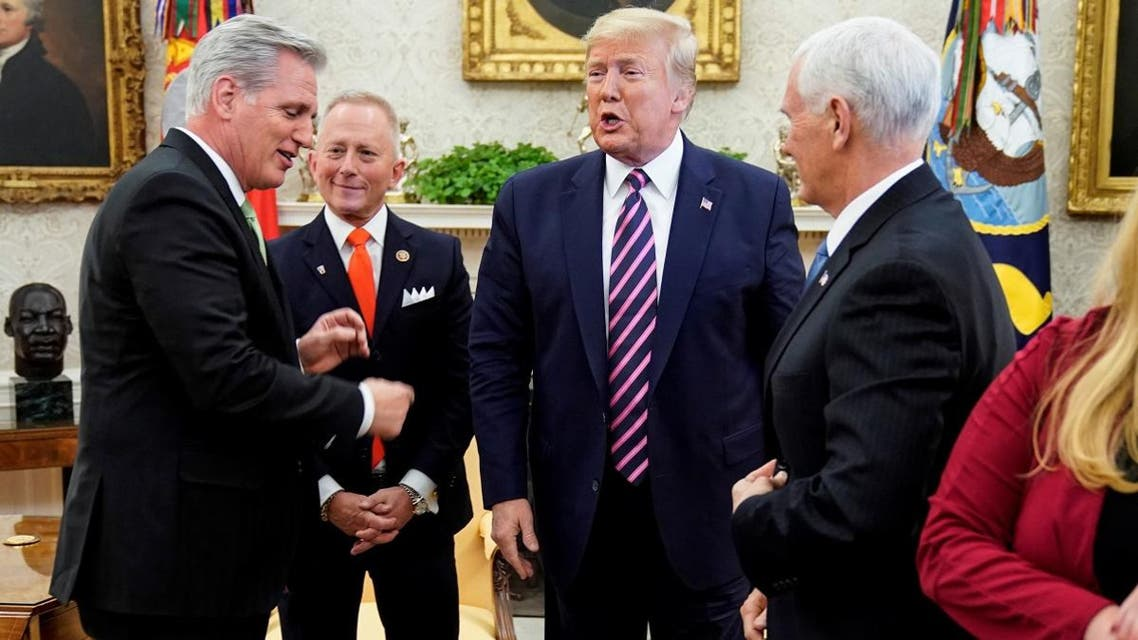 House Minority Leader Kevin McCarthy (R-CA) points to US President Donald Trump as he meets with US Representative Jeff Van Drew (D-NJ), a Democratic lawmaker who opposed his party's move to impeach Trump, in the Oval Office of the White House in Washington, US, on December 19, 2019. (Reuters)