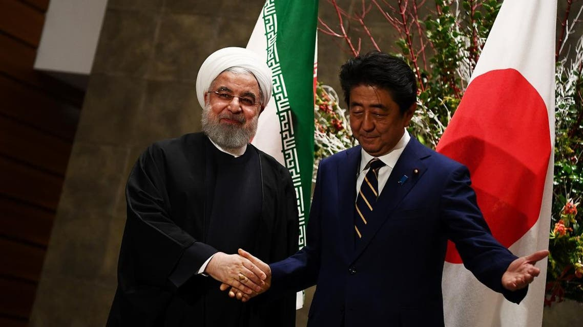 Japanese Prime Minister Shinzo Abe and Iranian President Hassan Rouhani meet in Tokyo, Japan, on December 20, 2019. (Reuters)