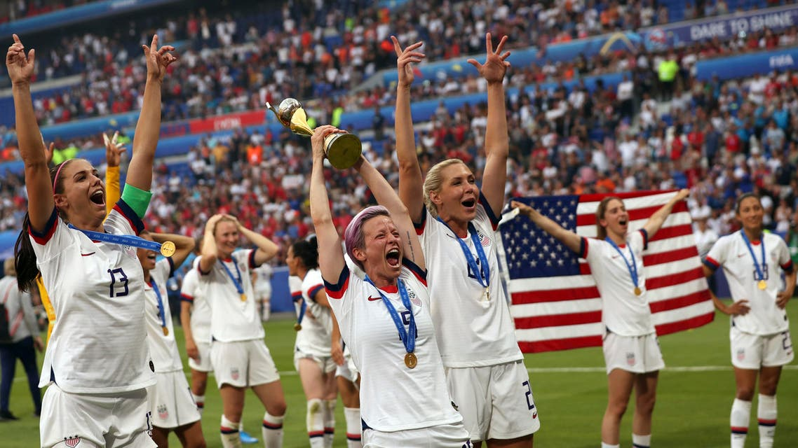 United States' Megan Rapinoe, center, holds the trophy as she celebrates with teammates after they defeated the Netherlands 2-0 in the Women's World Cup final soccer match at the Stade de Lyon in Decines, outside Lyon, France, Sunday, July 7, 2019. (AP)