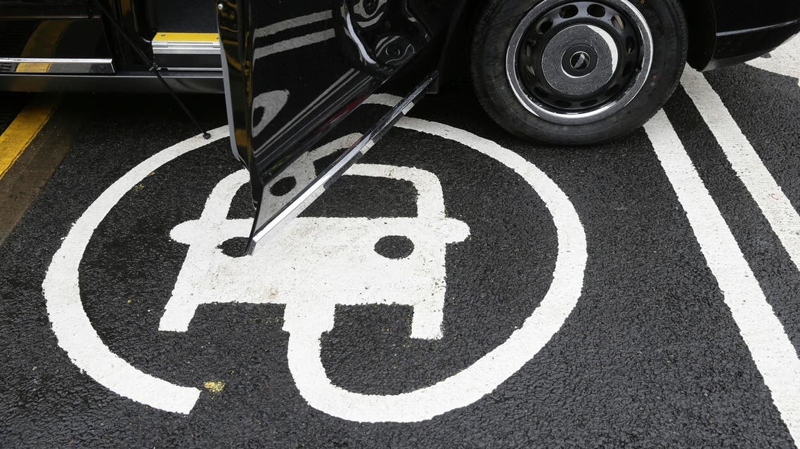 The electric car recharging sign, as a new TX Cab London taxi is parked at a charging station during a media opportunity at a Shell petrol station on Holloway road, in London, Wednesday Oct. 18, 2017, 2017. (AP)