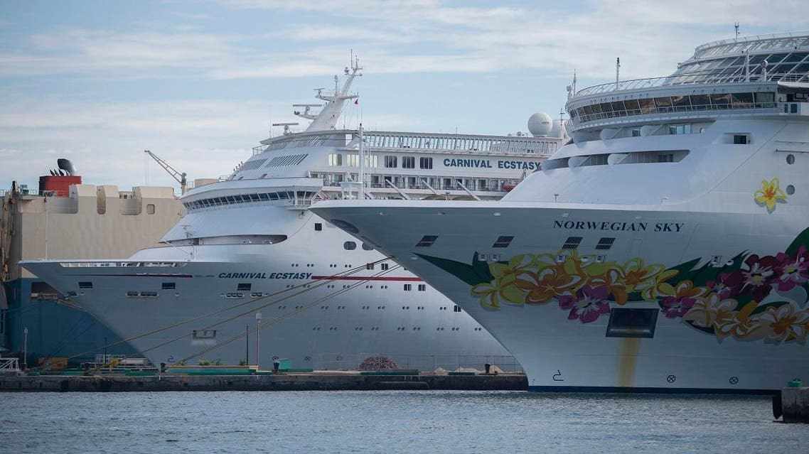 A Norwegian Cruise Line ship and Carnival ship are docked at the port in Nassau, Bahamas. (AFP)