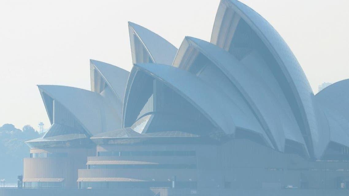 Smoke from bushfires shrouds the Sydney Opera House in Sydney, Australia. (Photo: Reuters)