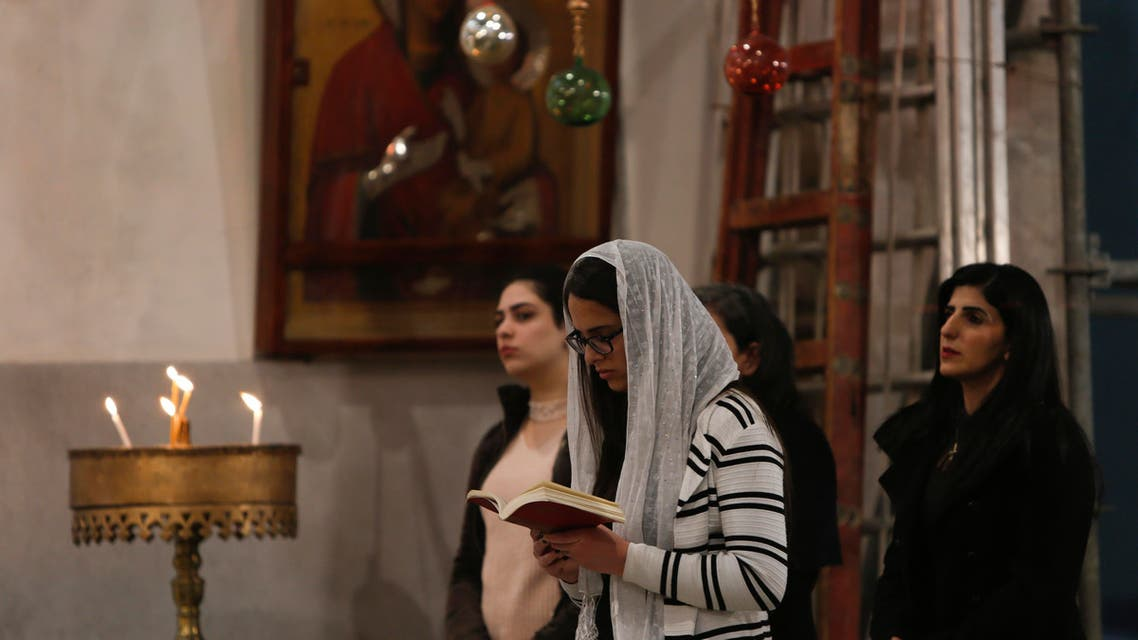 A worshipper prays inside the Church of the Nativity in Bethlehem on December 24, 2017. (File photo: AP)