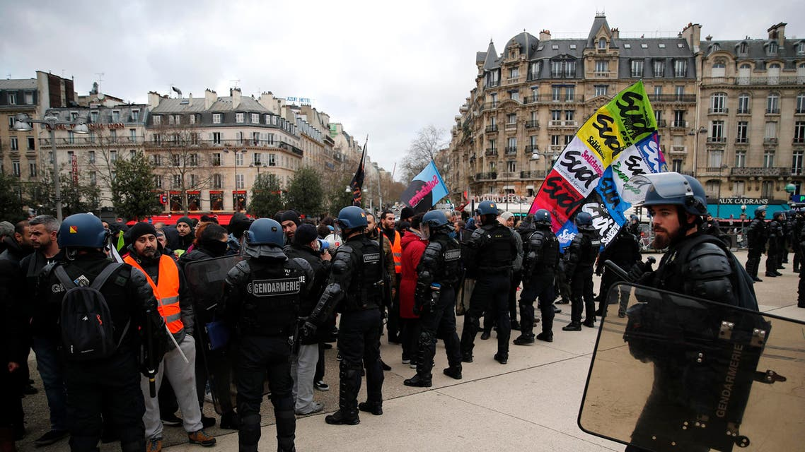 Riot police officers face striking train workers outside the the Gare de Lyon train station Monday, Dec. 23, 2019 in Paris.  (AP)