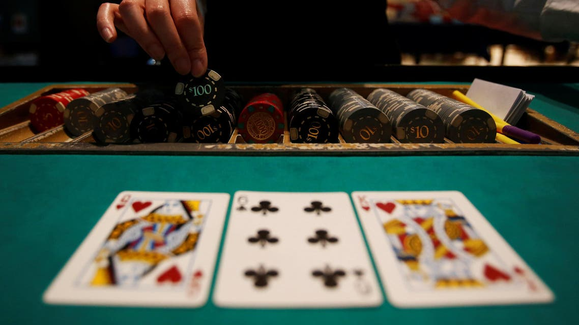 A dealer picks up chips on a mock black jack casino table during a photo opportunity at an international tourism promotion symposium in Tokyo, Japan September 28, 2013. REUTERS/Yuya Shino/File Photo