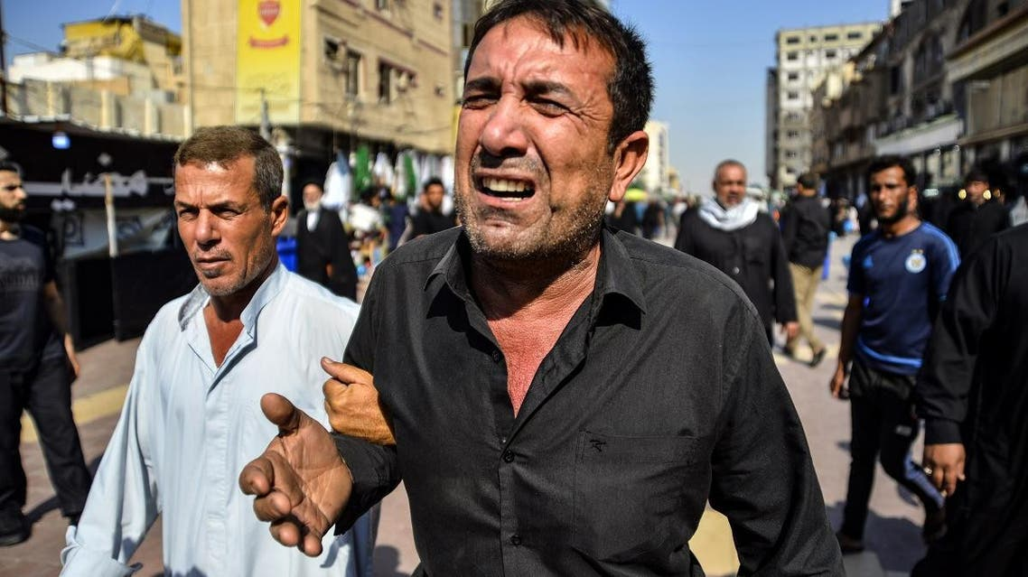 Iraqis mourn a demonstrator reportedly killed the day before during anti-government protests in the eastern city of Diwaniya, during his funeral in the central holy shrine city of Najaf on October 26, 2019.