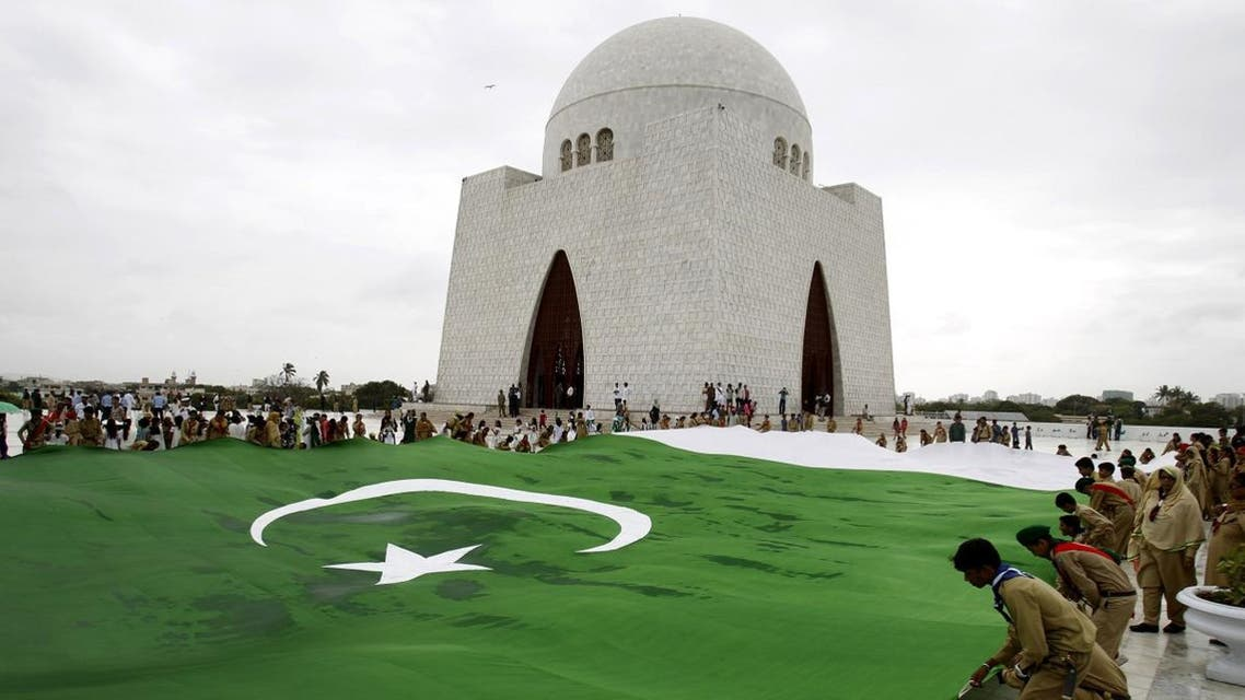 Students hold a giant representation of a Pakistani flag at the mausoleum of Muhammad Ali Jinnah, founder of Pakistan in Karachi, Pakistan. (AP)