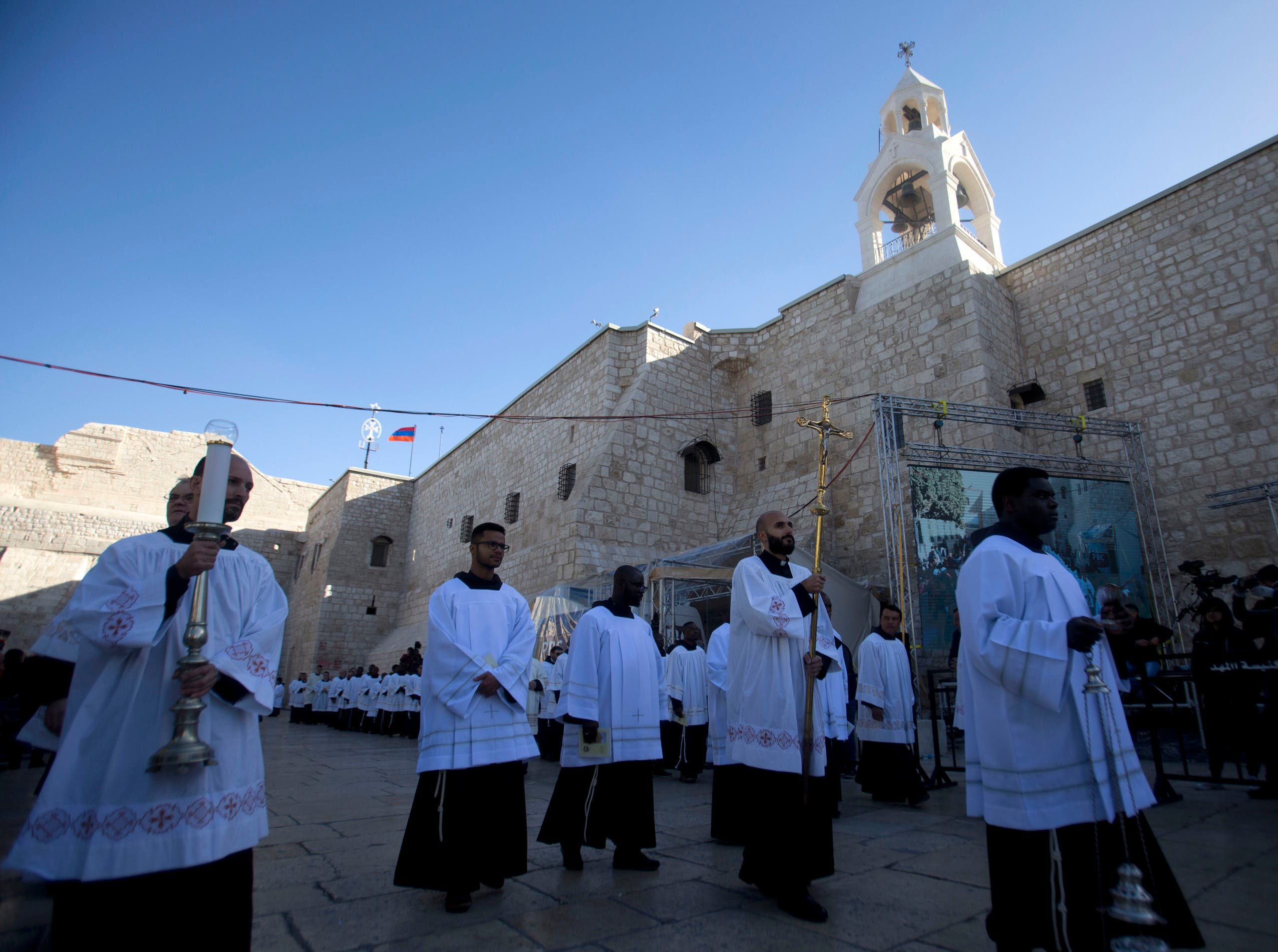 Clergymen participate in Christmas celebrations outside the Church of the Nativity, on Christmas Eve, in the West Bank City of Bethlehem, on December 24, 2019. (AP)