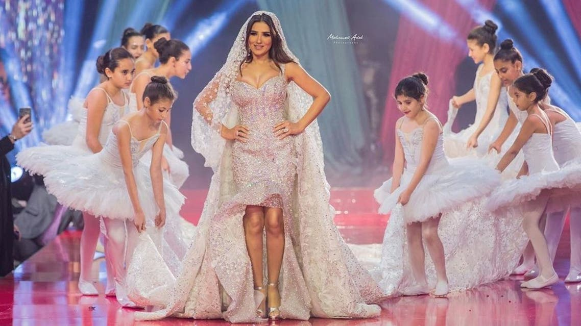 النجمة مي عمر ترتدي أغلى ثوب زفاف في العالم