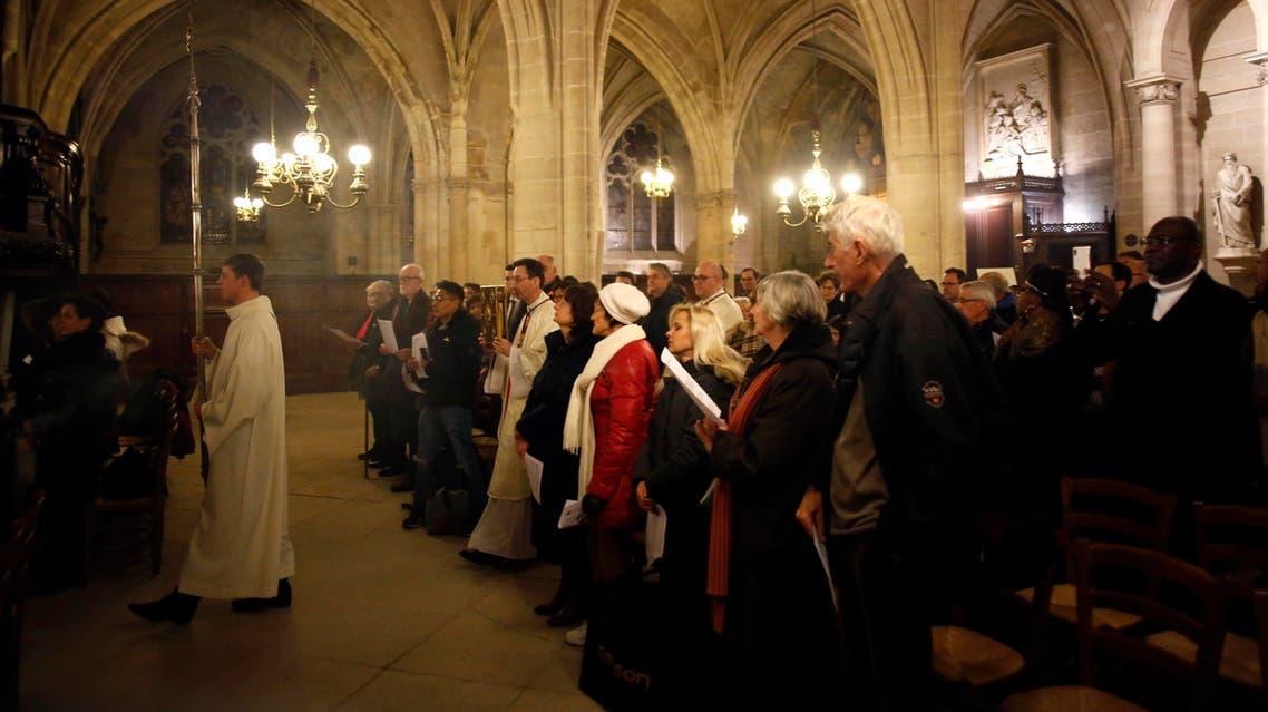 Worshippers the christmas mass, in Saint-Germain l'Auxerrois church, in Paris, Tuesday, Dec. 24, 2019. (AP)