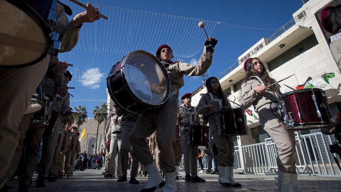 A Palestinian Scout marching band parades during Christmas celebrations outside the Church of the Nativity, built atop the site where Christians believe Jesus Christ was born. (AP)