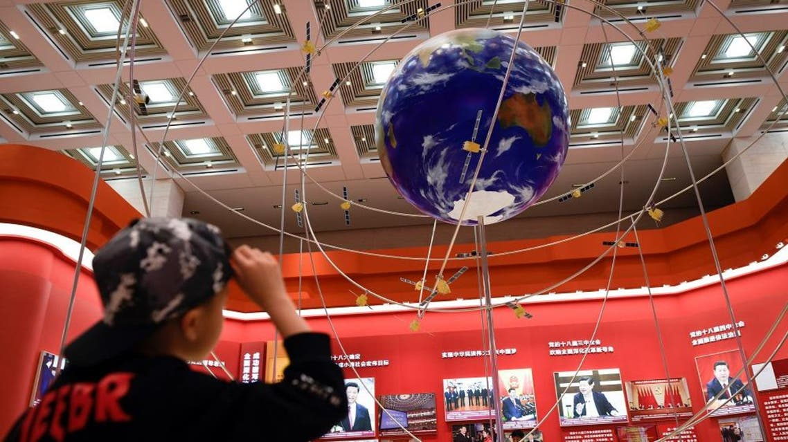 A boy looks at the BeiDou Navigation Satellite System at an exhibition marking the 40th anniversary of China's reform and opening up at the National Museum of China in Beijing on February 27, 2019. (File photo: AFP)