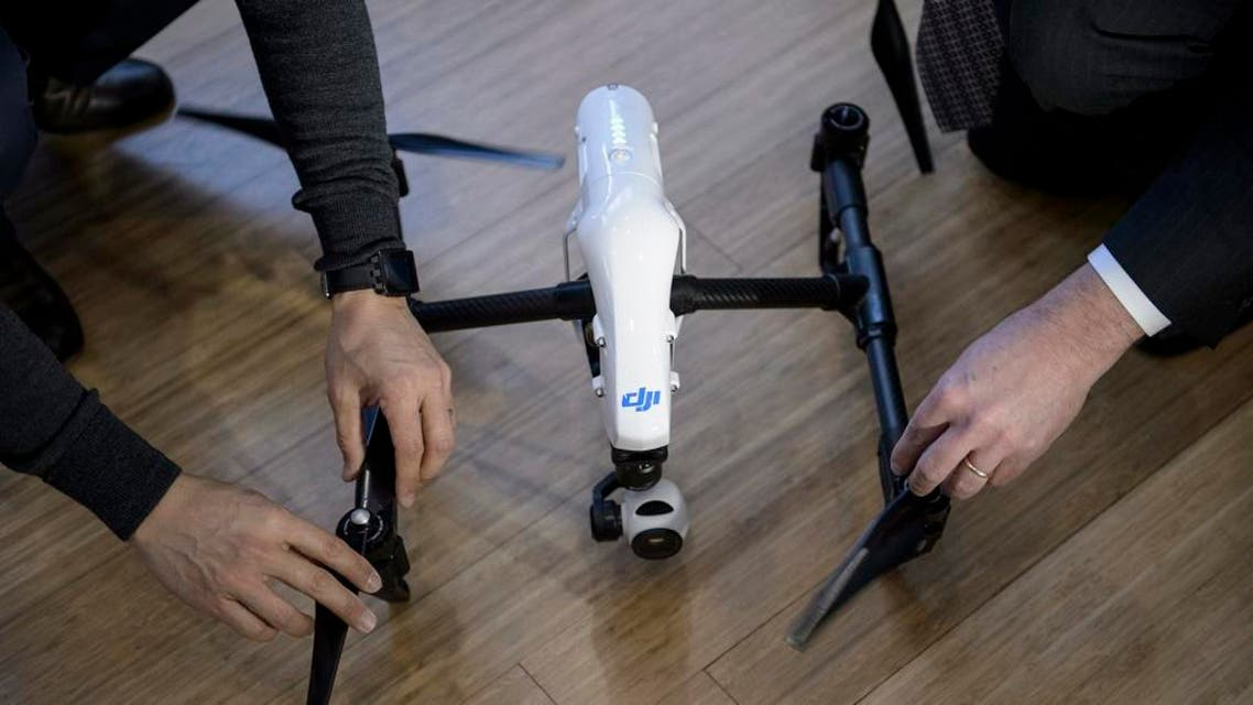 Staff from aerial imaging company DJI assemble a drone. (File photo: AFP)