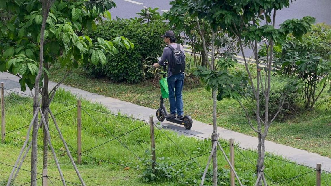 A GrabFood deliveryman riding his electric scooter. (File photo: AFP)