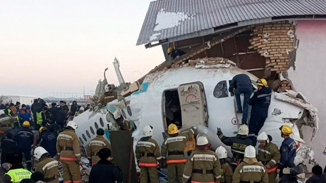 Police and rescuers work on the site of a plane crash near Almaty International Airport, outside Almaty, Kazakhstan, Friday, Dec. 27, 2019. (Photo: AP)