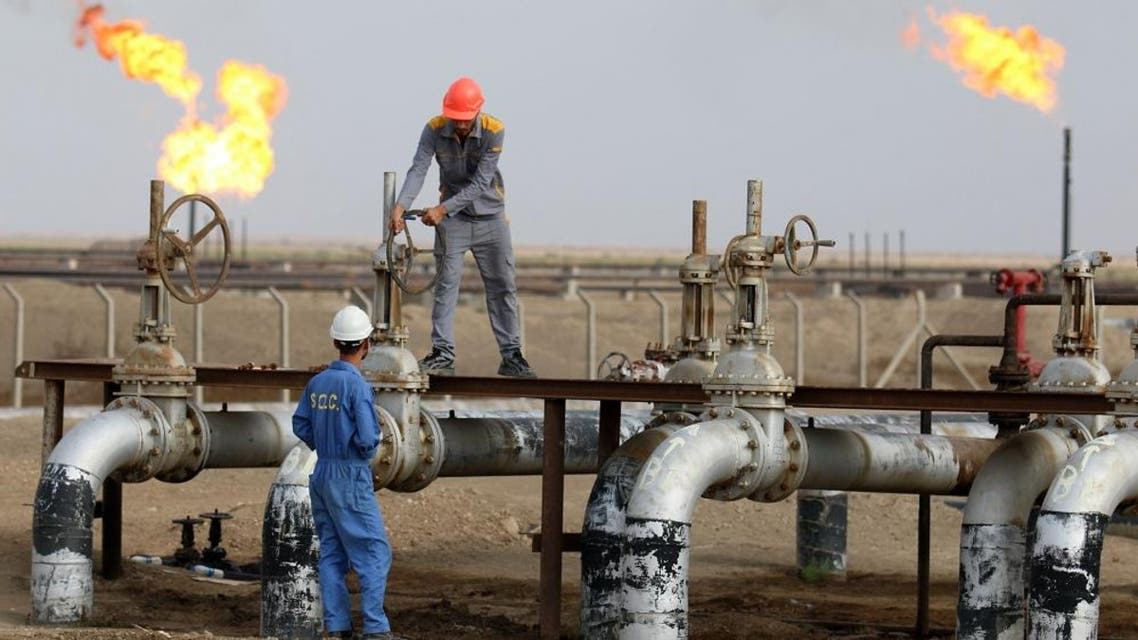 Iraqi labourers work at an oil refinery in the southern town Nasiriyah. afp