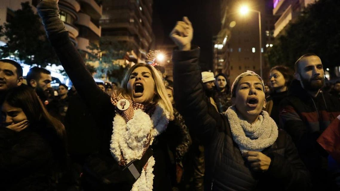 Lebanese protesters shout slogans as they gather outside the house of Lebanon's new prime minister in the capital Beirut. (AFP)