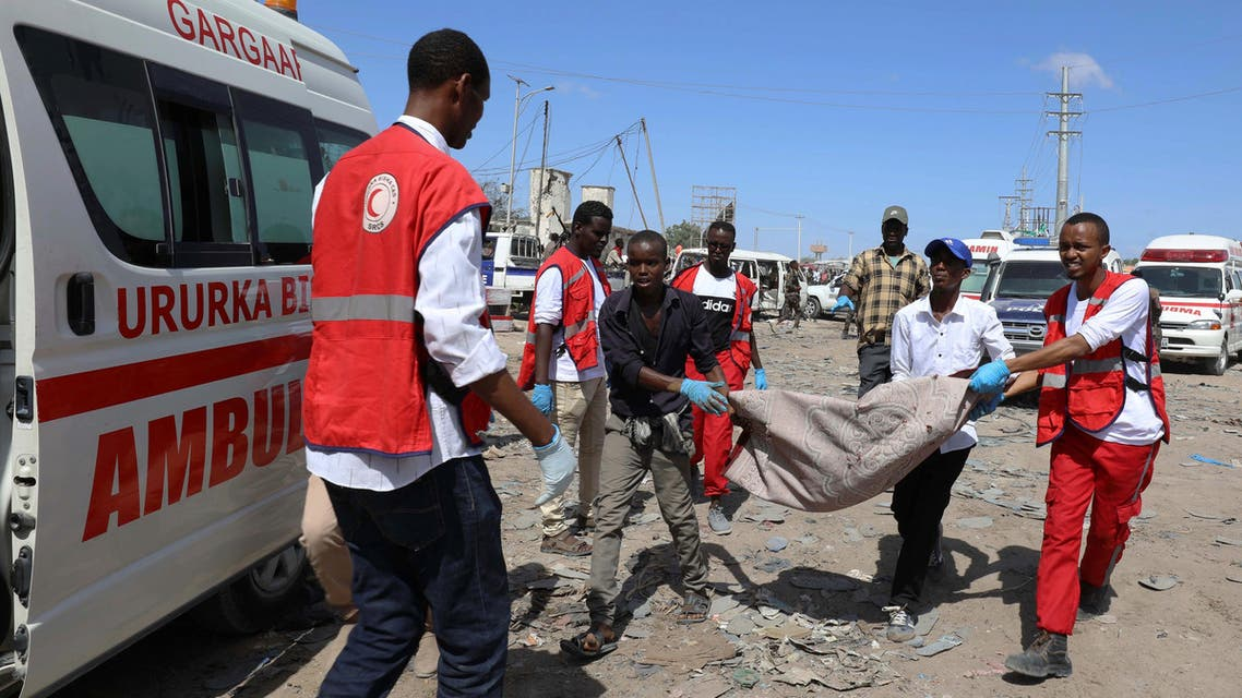 Civilians carry the dead body of a man killed in a car bomb explosion at a checkpoint in Mogadishu. (Photo: Reuters)