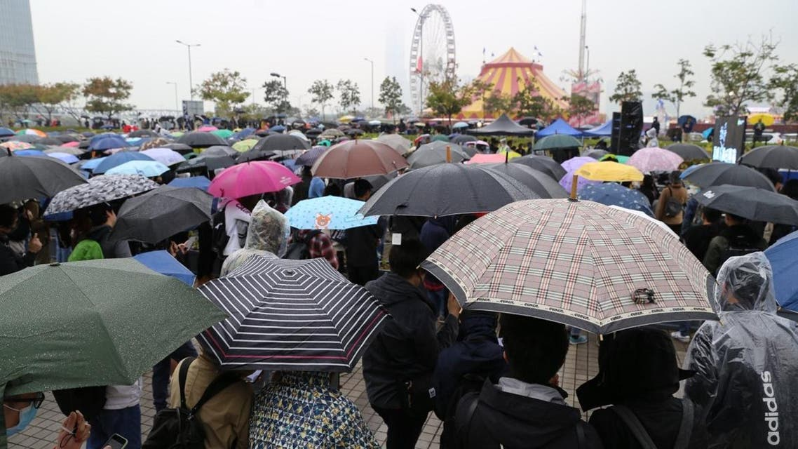 More than 1,000 people rallied in the rain in a park in Hong Kong's financial district on Sunday, chanting slogans for democracy. (via Twitter)
