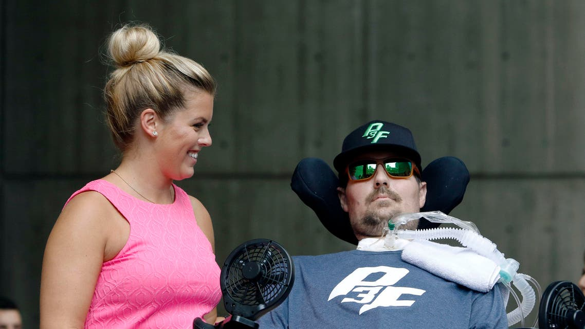 Pete Frates, right, who inspired the ice bucket challenge, sits beside his wife Julie is during a ceremony at City Hall in Boston where Tuesday, Sept. 5, 2017 was declared Pete Frates Day by Boston Mayor Marty Walsh. (AP)
