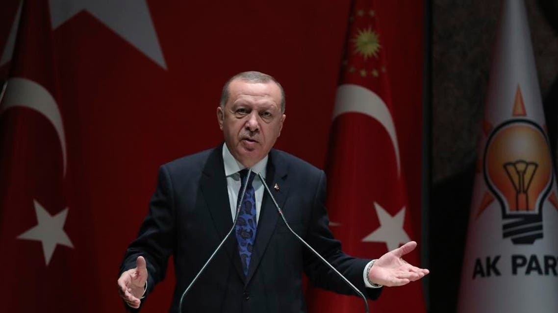 """Turkey's President Recep Tayyip Erdogan addresses the members of his ruling party, in Ankara, Turkey, Thursday, Dec. 26, 2019. Erdogan says Thursday his government will submit a bill to parliament that would allow Turkey to send troops to Libya, in support of the U.N.-backed government there. Erdogan said the Libyan government, which controls the capital, Tripoli, has """"invited"""" Turkey to send troops. (Turkish Presidency via AP, Pool)"""