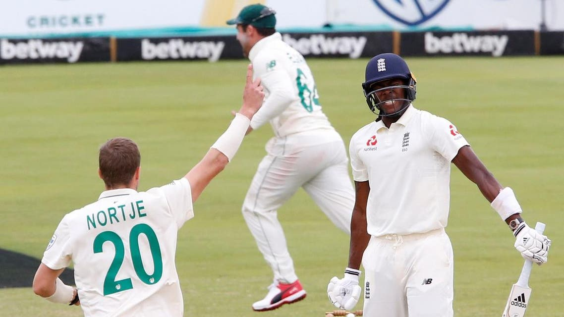 England's Jofra Archer looks dejected after losing his wicket off the bowling of South Africa's Anrich Nortje , caught by Rassie van der Dussen. (REuters)
