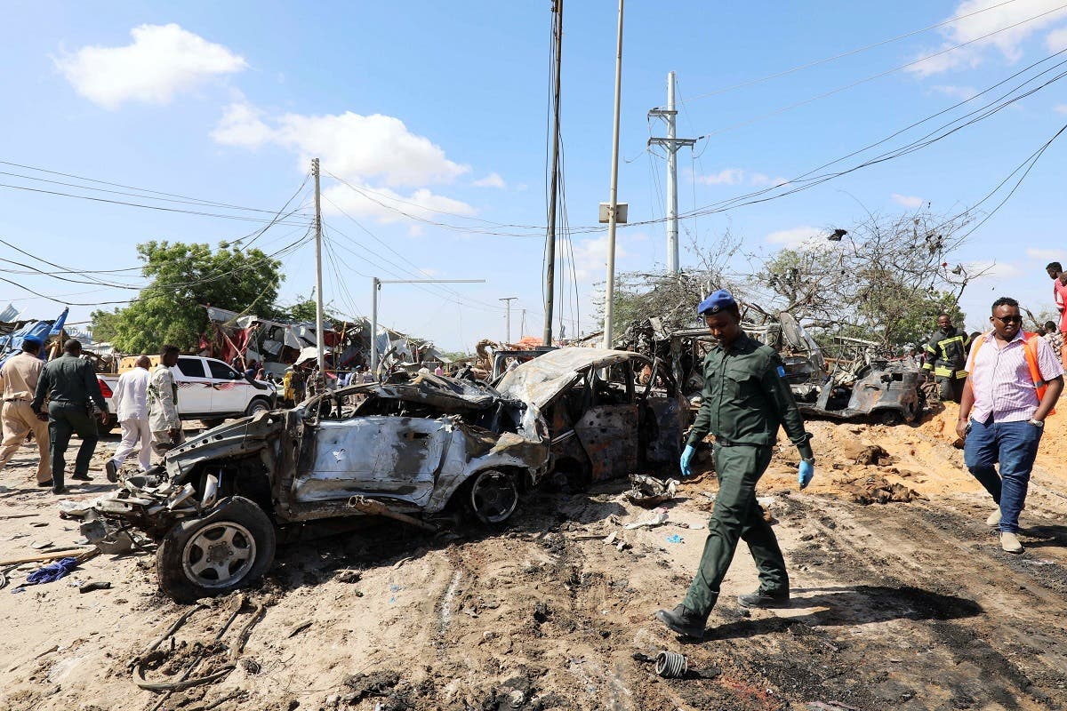 A Somali police officer walks past a wreckage at the scene of a car bomb explosion at a checkpoint in Mogadishu, Somalia. (File photo: Reuters)