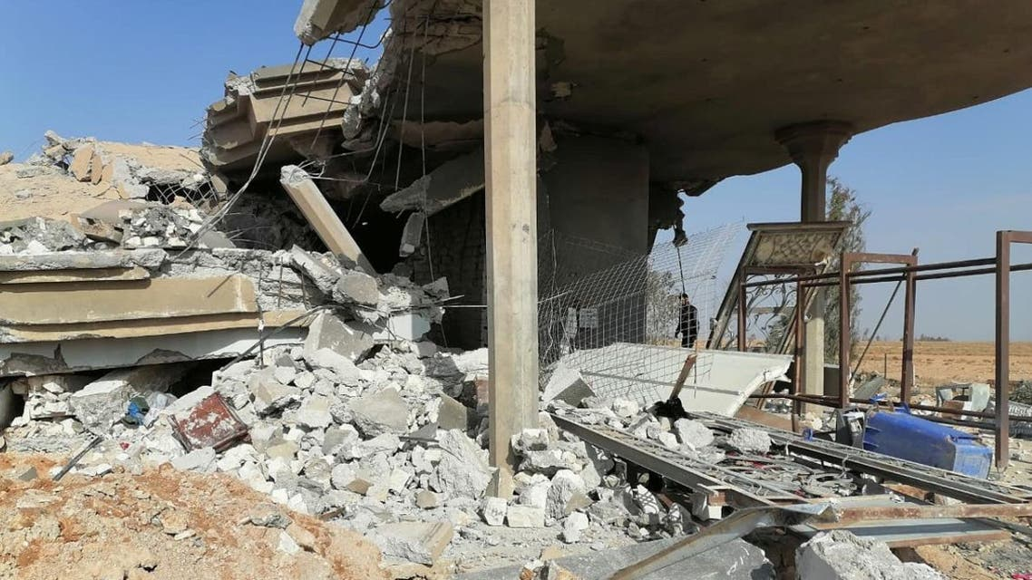 Destroyed headquarters of Kataib Hezbollah militia group are seen after in an air strike in Qaim, Iraq, on December 30, 2019. (Reuters)