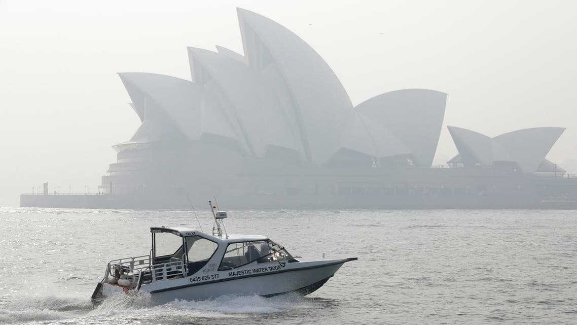 A water taxis drives by as smoke haze hangs over the Sydney Opera House in Sydney, Thursday, Nov. 21, 2019. (AP)